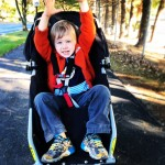 Four year old in running stroller
